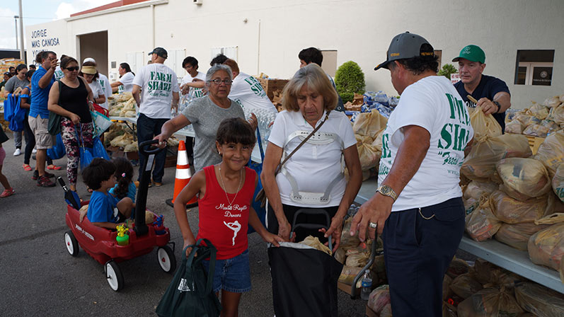 A young girl and her grandmother receive food assistance in Sweetwater, fL